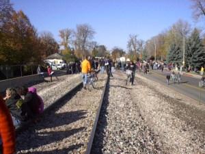 Crowds gather on railroad tracks